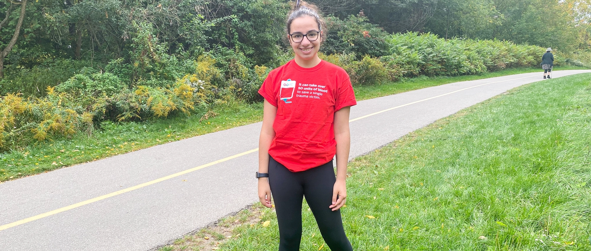 Natalie Pallisco plasma recipient and blood donor posing while out for a run