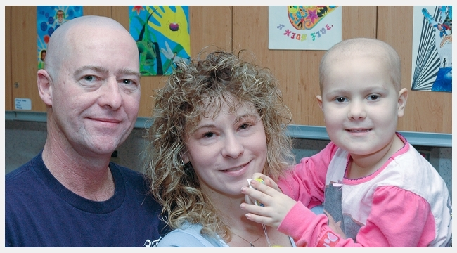 Five-year-old Rachelle with her family while in treatment for cancer