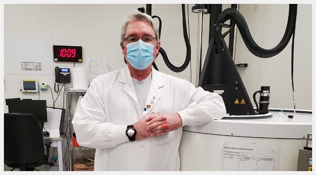 James McCarroll, a medical laboratory technologist, leans on a piece of equipment at a Canadian Blood Services facility that processes stem cells for autologous stem cell transplants.