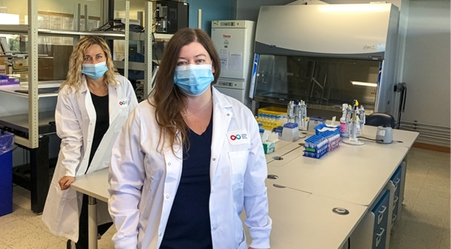 Dr. Olga Mykhailova (Left) and Tracey Turner (Right) standing in the lab where they helped label more than 52,000 red blood cell images.